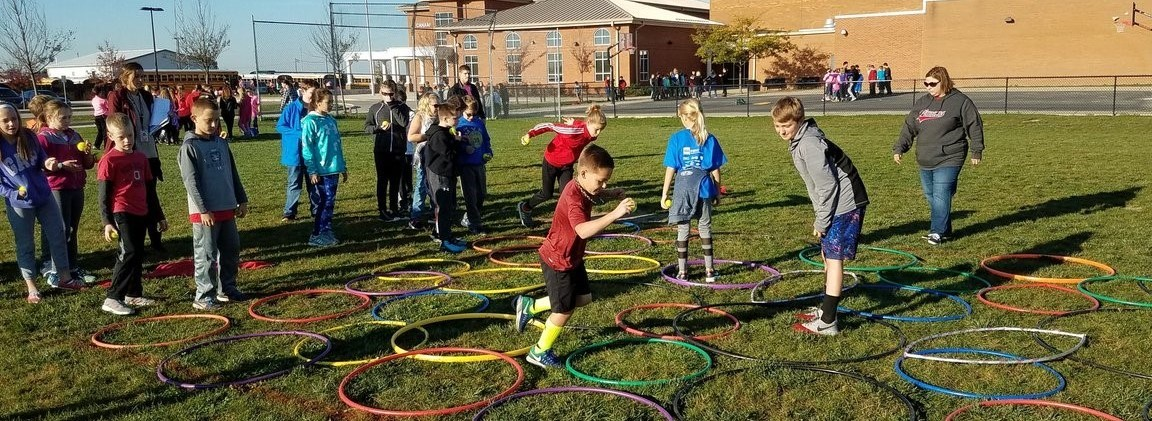 Photo of CMS students playing a hula hoop game on unity day