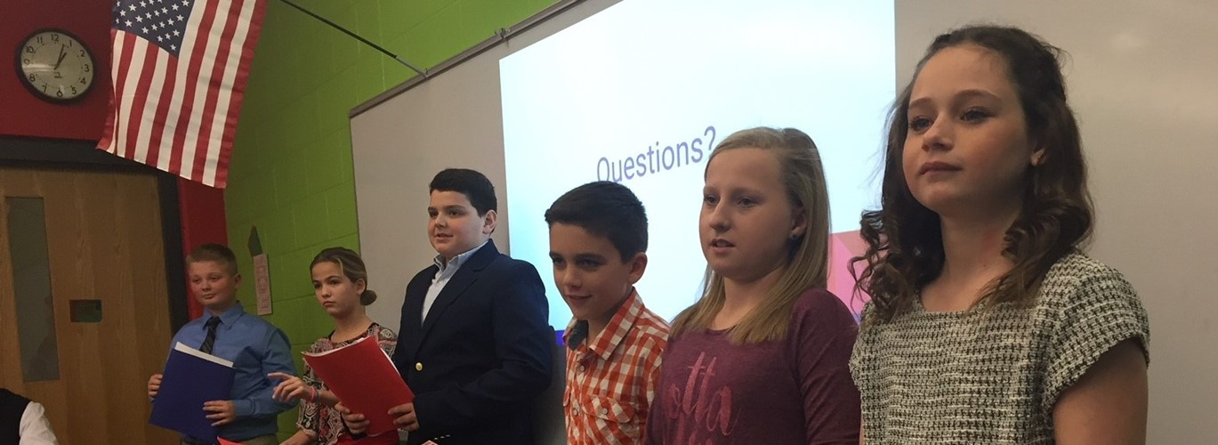 Photo of CMS students presenting to the board