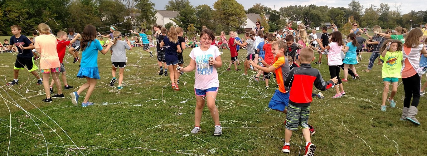Students having a silly string battle