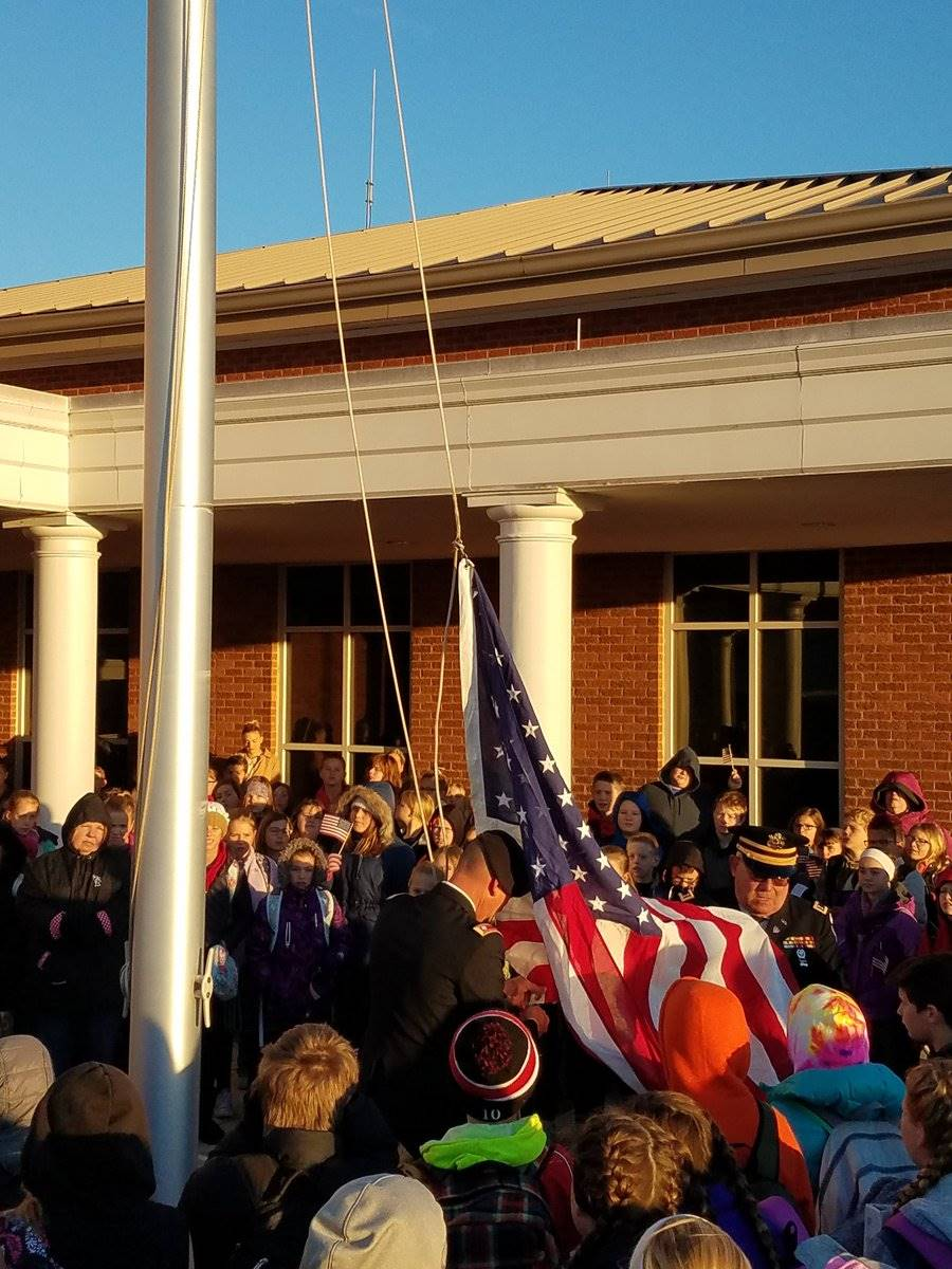 Soldiers raising the flag on veterans day at CMS