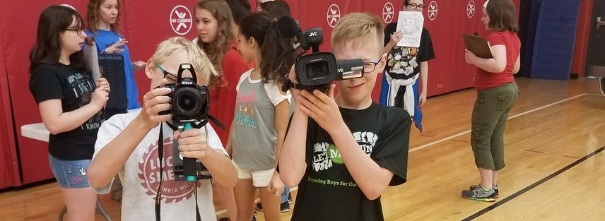 Photo of students using cameras at CMS Career Day