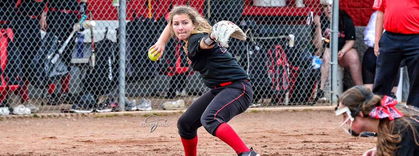 Photo of HS softball player throwing the ball