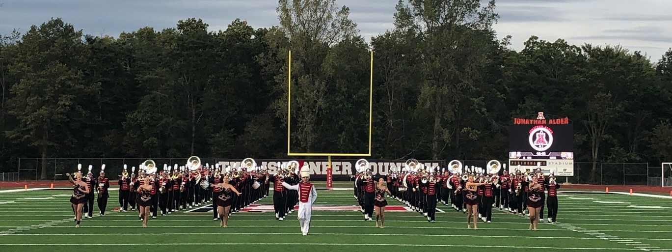 Photo of the JAHS Marching Band taking the field