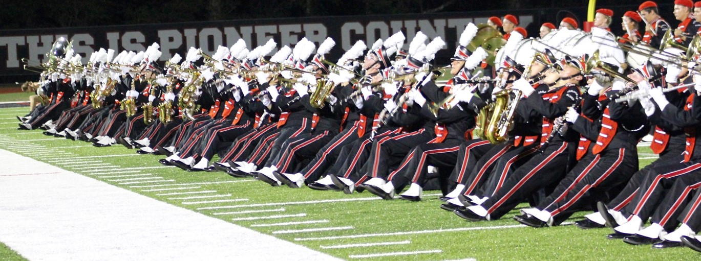 Photo of JAHS band kneeling