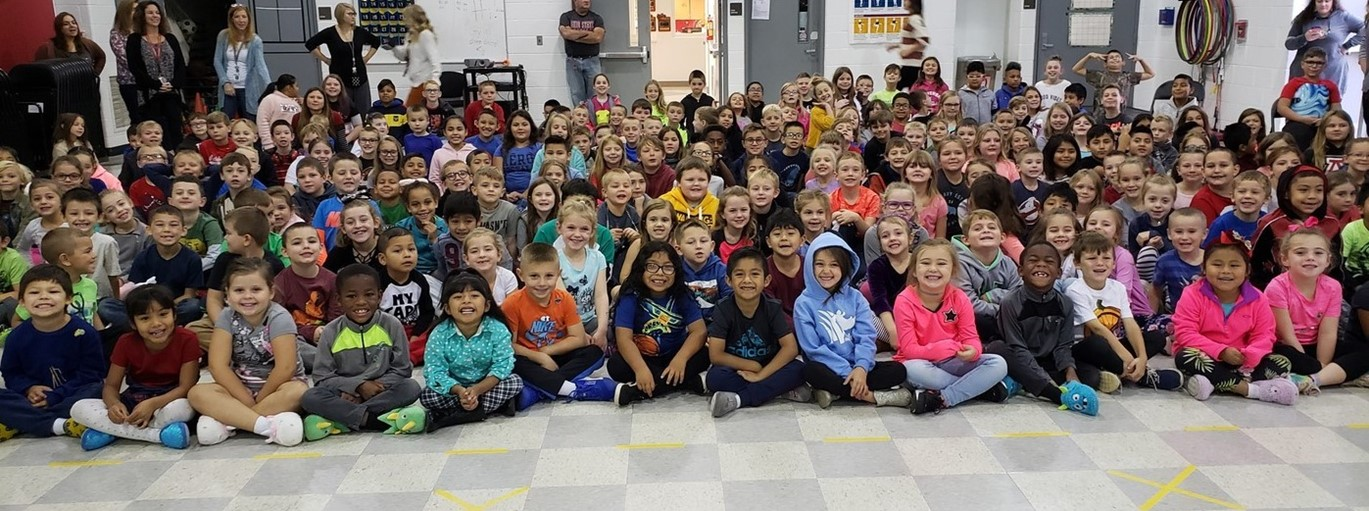 Photo of student assembly at Monroe Elementary