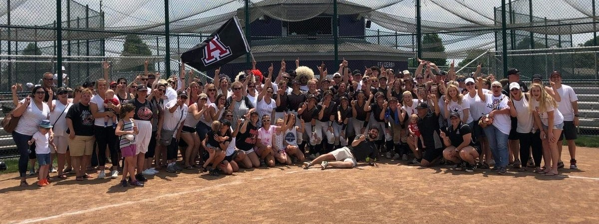 Photo of softball team and fans after winning to advance to state final four