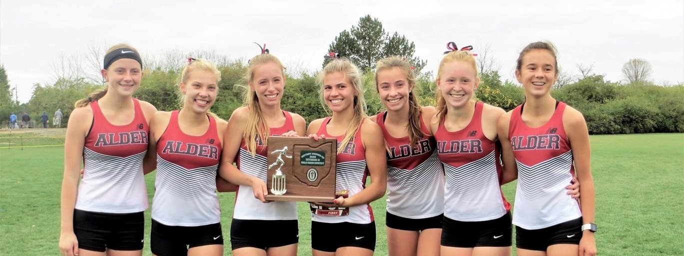 Cross country girls team holding trophy