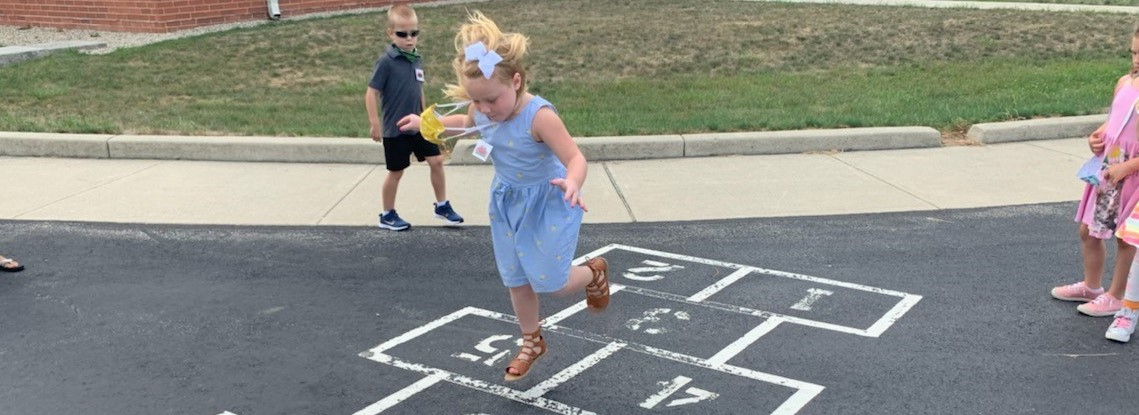 Picture of student playing hop scotch