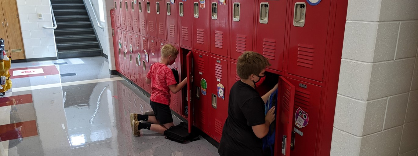 Picture of students at their locker